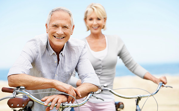 Couple with bikes smiling