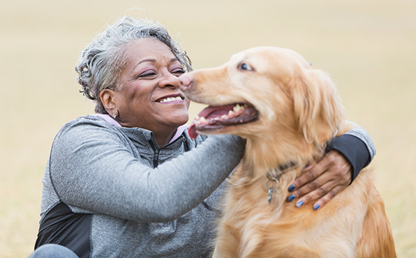 Woman happy with pet dog